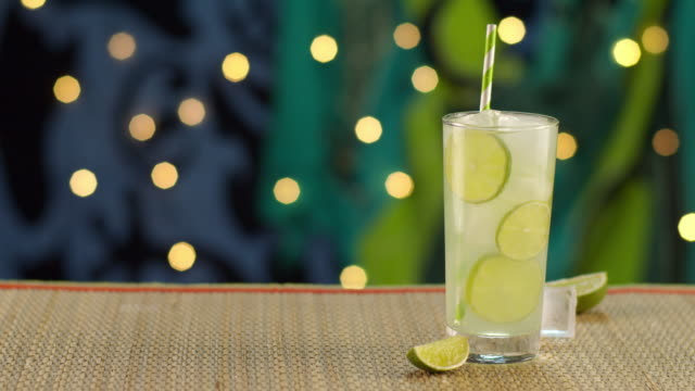 tropical lime drink splashing in ice - tropical drink stock videos & royalty-free footage