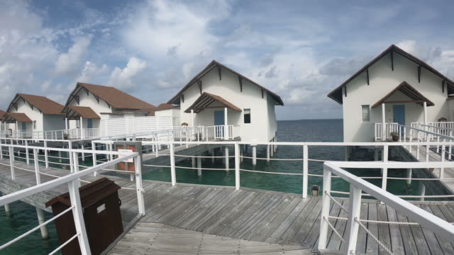 tropical maldives bungalow resort hotel and island in maldives - bungalow stock videos and b-roll footage
