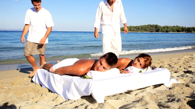 tropical massage on the beach. - massaging stock videos and b-roll footage