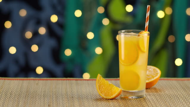 tropical orange drink pouring in ice - tropical drink stock videos & royalty-free footage