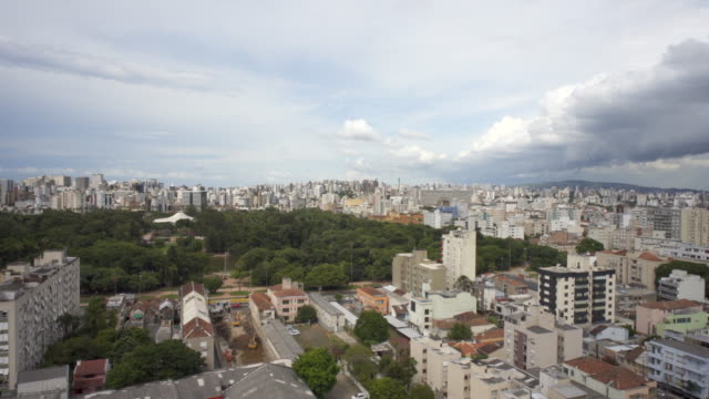 a tropical storm in summer passing over the skyline of porto alegre, southern brazil - porto alegre stock-videos und b-roll-filmmaterial