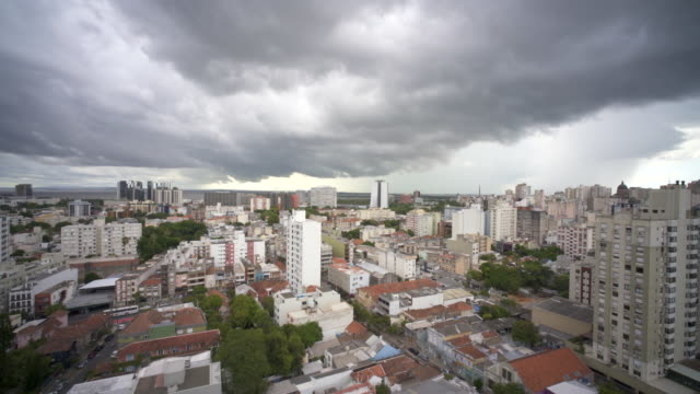 a tropical storm in summer passing over the skyline of porto alegre, southern brazil - alegre stock videos & royalty-free footage