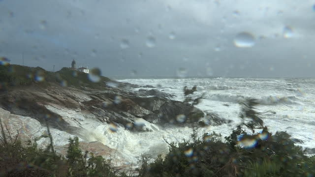 tropical storm waves crash into the rocky coastline at beavertail state park in jamestown, rhode island. - hurricane irene stock videos & royalty-free footage