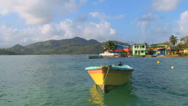tropical water scene with pastels and boat - panama stock videos & royalty-free footage