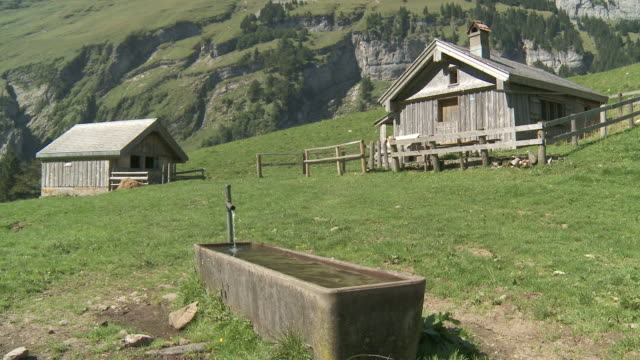 ms trough in mountains with hut pasture / appenzell, appenzell innerhoden, switzerland - washtub stock videos and b-roll footage
