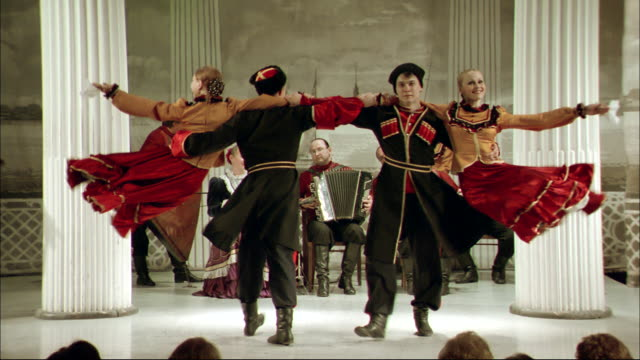 vídeos de stock, filmes e b-roll de a troupe performs a traditional russian dance. - russia