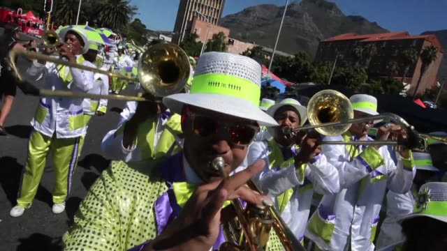 troupes of performers marched saturday in the annual cape town minstrels carnival playing ghoema music comic songs often accompanied by brass or banjo - banjo stock videos & royalty-free footage