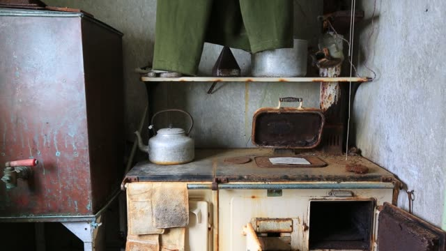 trousers drying above the kitchen stove in station w an old british scientific research station on detaille island graham land antarctica - cooker stock videos & royalty-free footage