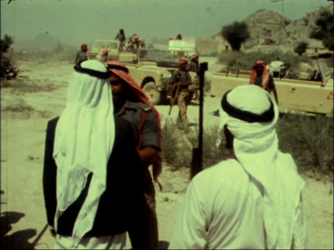 trucial scouts arabian gulf trucial oman ms landrover towards along desert lame camel hurries out of way track by side of driver rl cms two scouts in... - vereinigte arabische emirate stock-videos und b-roll-filmmaterial