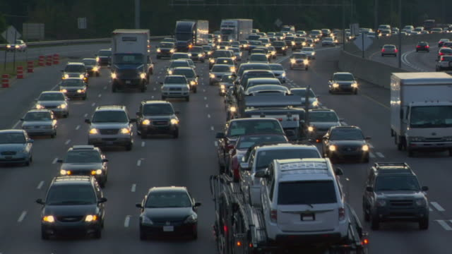 HA WS Truck and cars changing lanes in traffic on crowded highway at dusk / Atlanta, Georgia, USA