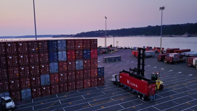 truck being loaded in port container yard - lastzug stock-videos und b-roll-filmmaterial