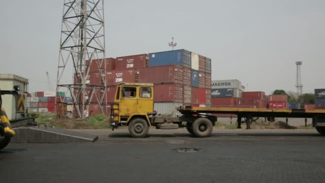 truck being loaded with a container near stacked containers at the haldia dock complex part of the kolkata port trust in haldia west bengal india on... - west bengal stock videos and b-roll footage
