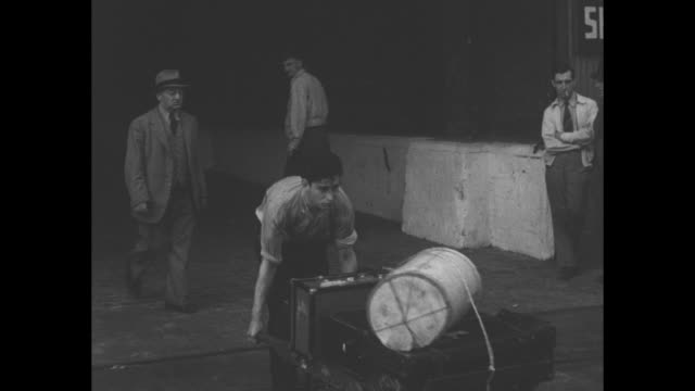 truck carries stacks of suitcases and trunks unloaded from the rms antonia after the ship's arrival in montreal harbor bus in background has sign... - unloading stock videos & royalty-free footage