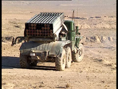 a truck carrying a rocket launcher moves in reverse in a desert - rocket launcher stock videos & royalty-free footage