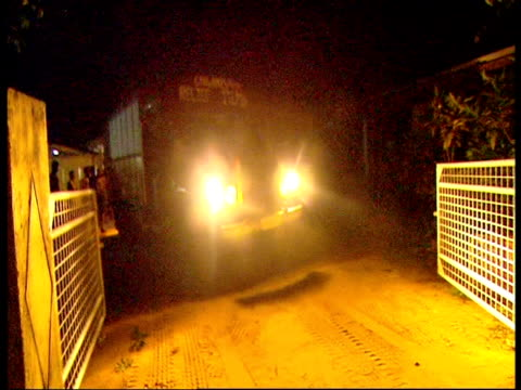 A truck carrying humanitarian aid supplies arrives in Mullaitivu under cover of darkness