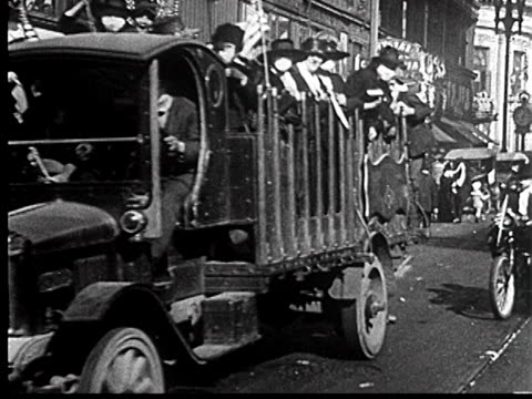 b/w 1918 truck carrying people with masks on during liberty loan parade / san francisco / newsreel - 1918 stock videos & royalty-free footage
