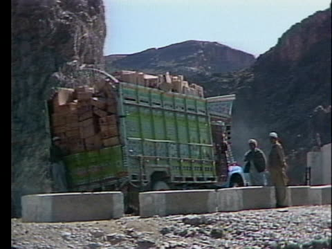a truck carrying smuggled goods drives along the khyber pass highway - crime or recreational drug or prison or legal trial stock videos & royalty-free footage