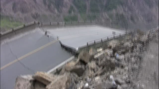 a truck carrying survivors drives next to a fractured road following the 2008 sichuan earthquake in china - earthquake stock videos & royalty-free footage