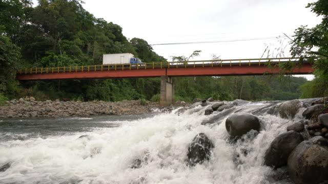 la truck crossing a bridge somewhere in costa rica - latin america stock videos and b-roll footage