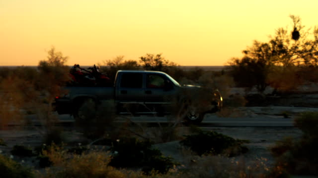 truck drive by sunrise/sunset - pick up truck stock videos and b-roll footage