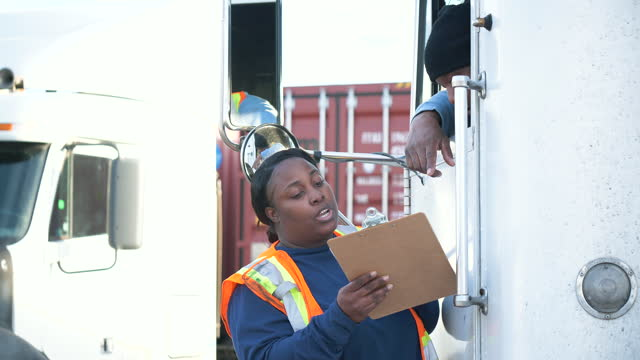 truck driver, female freight worker with clipboard - gesturing stock videos & royalty-free footage