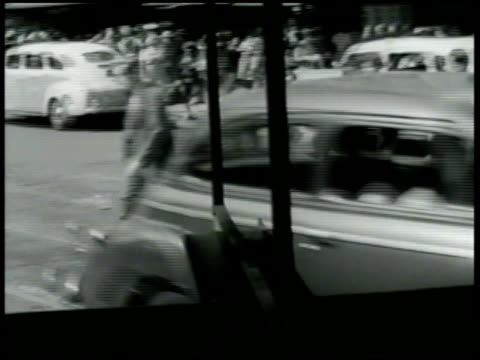vídeos de stock, filmes e b-roll de ws driving down new york city making turn going down street two marines talking 'i never thought the war could seem so far away' wwii - 1942