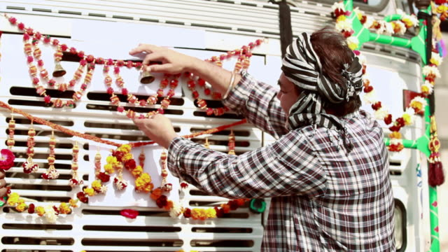 truck driver ringing bell and decorating his new truck, ballabgarh, haryana, india - decoration stock videos & royalty-free footage