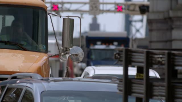 Truck driver waits in traffic jam on busy Manhattan Bridge.