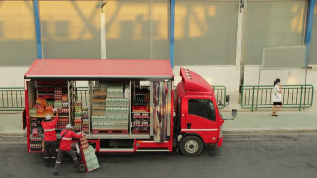 truck drivers delivery good, offloading truck wearing face mask during corona virus pandemic in bangkok. service delivery. - cold drink stock videos & royalty-free footage