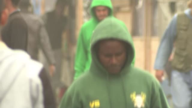 truck drivers protest calling for calais migrant camp to be shut down malik speaking to reporter / man along through clais camp wearing 'i love... - sweatshirt stock videos & royalty-free footage