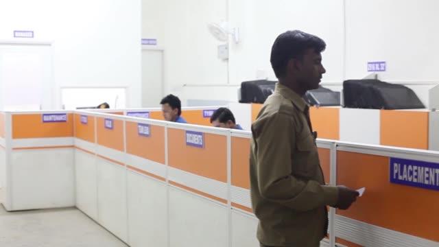 truck drivers sit at a rivigo services pvt depot in manesar haryana india on monday may 2 ashok leyland ltd employees work at a rivigo services pvt... - haryana stock videos & royalty-free footage