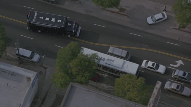 A S.W.A.T. truck drives down a busy street in Los Angeles.