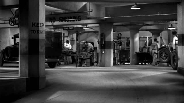 a truck drives into a car repair garage in 1935. - 1935 stock videos & royalty-free footage