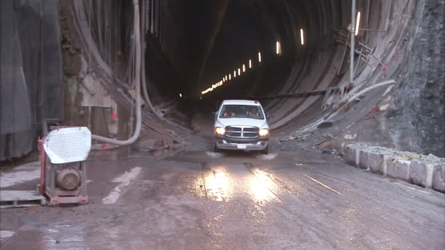 a truck drives out of a tunnel at a bore site on the niagara river. - river niagara stock videos & royalty-free footage