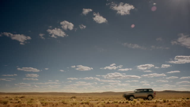 """truck drives through australian outback - """"bbc universal"""" stock videos & royalty-free footage"""