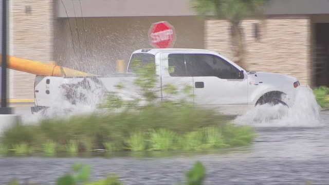 truck drives through flooded shopping mall parking lot after hurricane irma in naples florida - environment or natural disaster or climate change or earthquake or hurricane or extreme weather or oil spill or volcano or tornado or flooding stock videos & royalty-free footage