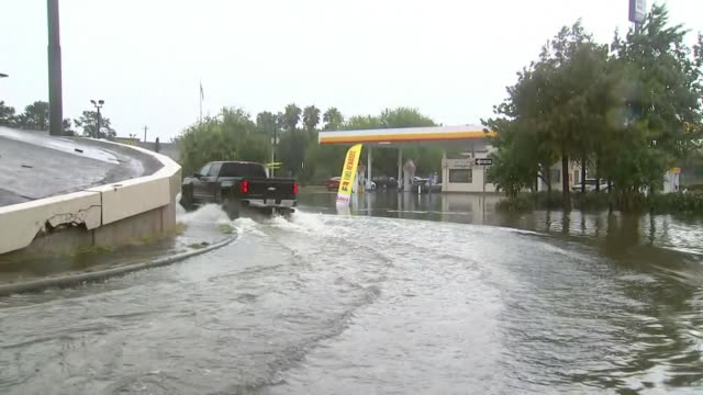 vídeos y material grabado en eventos de stock de truck drives through hurricane harvey flood-water filled streets in dickinson, texas 08/28/17 - environment or natural disaster or climate change or earthquake or hurricane or extreme weather or oil spill or volcano or tornado or flooding