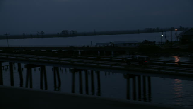 TS A truck driving across a causeway at night / New Orleans, Louisiana, United States