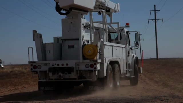ms truck driving down dirt road surounded by fields / hooker, ok, united states  - power cable stock videos & royalty-free footage