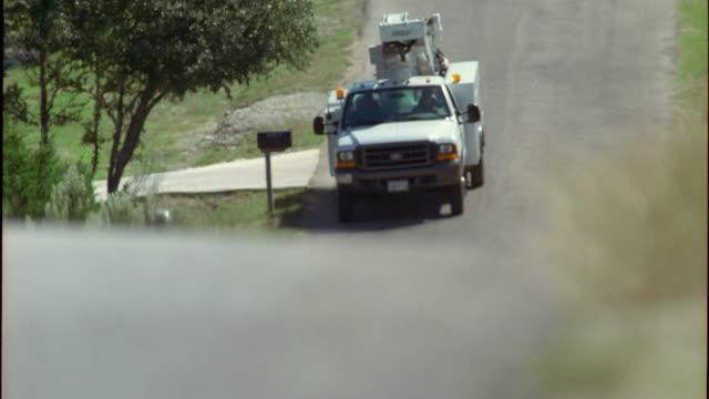 slo mo ms r/f truck driving down rural road / johnson city, texas, usa - johnson city texas stock videos & royalty-free footage