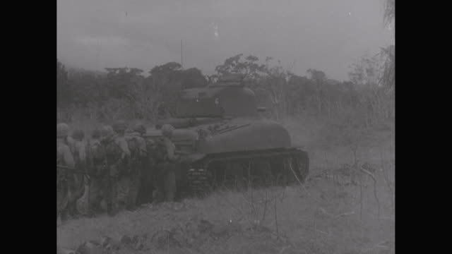 WS TD WWII, truck driving off boat into water, army slogging though mud, Army soldiers in combat, soldiers firing with rocket launcher / United States