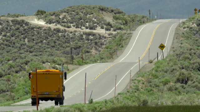 A truck driving on a long scenic road. - Slow Motion