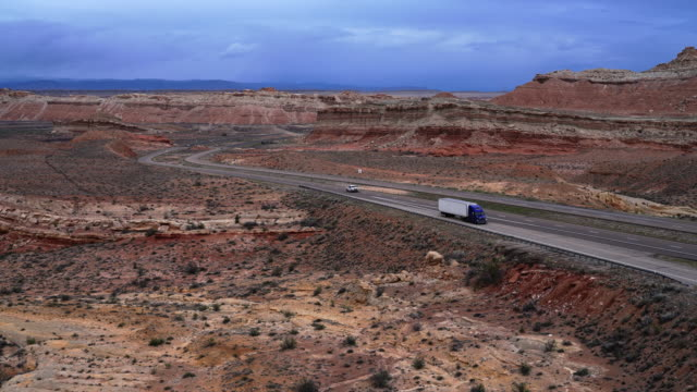truck driving on highway us-70 through coral canyon. the view from san rafael swell view point, utah, usa, in the early spring. - san rafael swell stock videos and b-roll footage