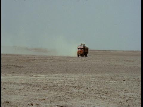 MWA Truck driving through desert, Gujarat, India