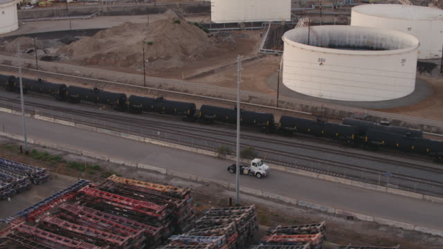 truck driving through oil refinery - port of los angeles stock videos & royalty-free footage
