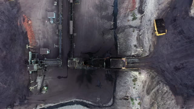 truck dump lignite coal into conveyor belt - conveyor belt stock videos & royalty-free footage