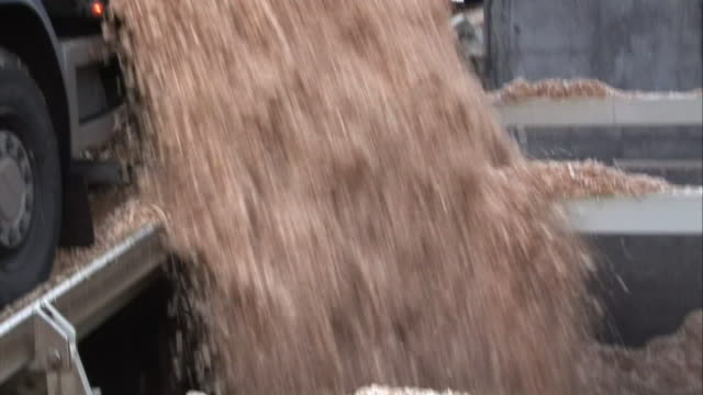 a truck dumps wood chips at a paper mill. - paper mill stock videos and b-roll footage
