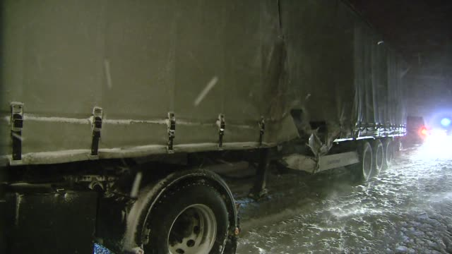 truck during snowstorm - articulated lorry stock videos & royalty-free footage