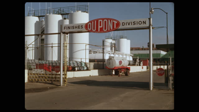 truck exits dupont finishes division factory gate - storage tank stock videos & royalty-free footage