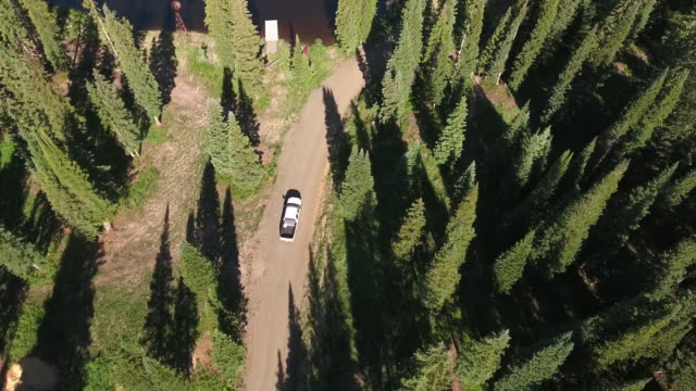 Truck follow to Lake Reveal Pan,Rocky Mountains Reveal Fall colors Lake Reflection, Off road, rzr Wildlife, Foliage SHORT Aerial, 4K, 32s, Stock Video Sale - Drone Discoveries - Drone Aerial View